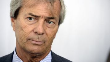 French Industrial group Bollore's head Vincent Bollore is seen on June 21, 2013 before he signs an agreement with Bordeaux's mayor and President of the Urban Community of Bordeaux (CUB) in Bordeaux, southwestern France. The three parties have agreed to launch the electric car rental service, operated by Bollore group, starting November 2013 in the city and its neighboring. AFP PHOTO / JEAN-PIERRE MULLER